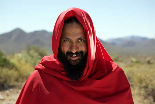 image of man with red cloth covering his head